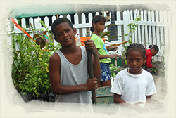 Placencia kids get to work making their Park lush and green